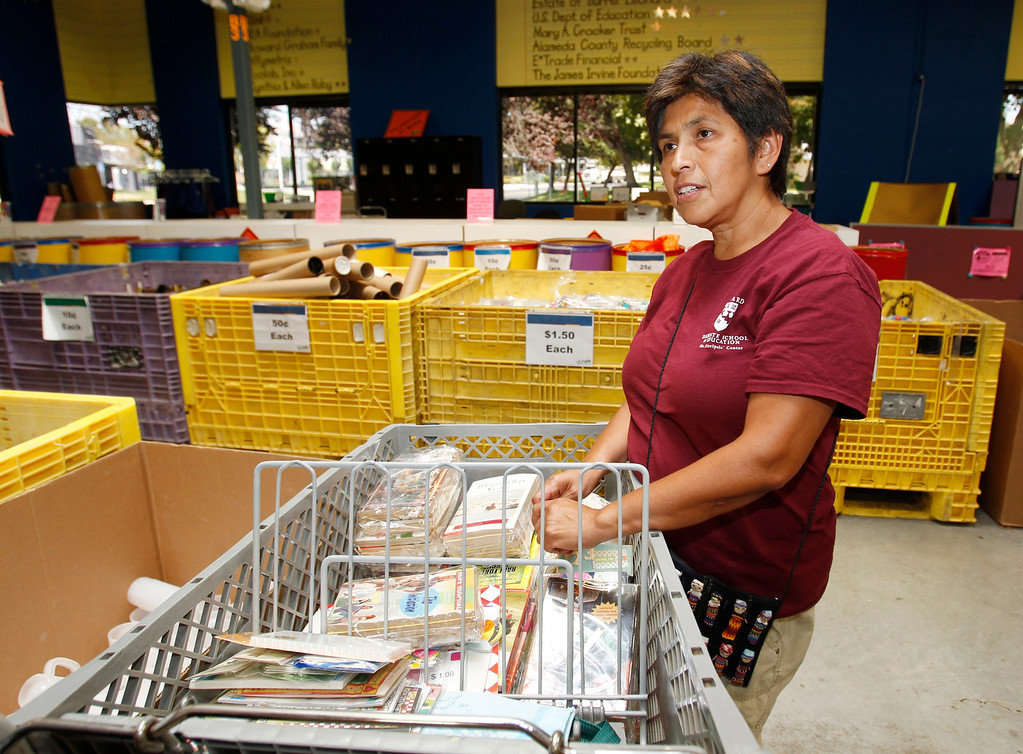 . Barron Park Elementary Principal Magdalena Fittoria talks to reporter about book supplies she has in the cart as she gets ready for the new school year at Resource Area For Teaching in San Jose, Calif., on Saturday, Aug. 10, 2013. (Josie Lepe/Bay Area News Group)