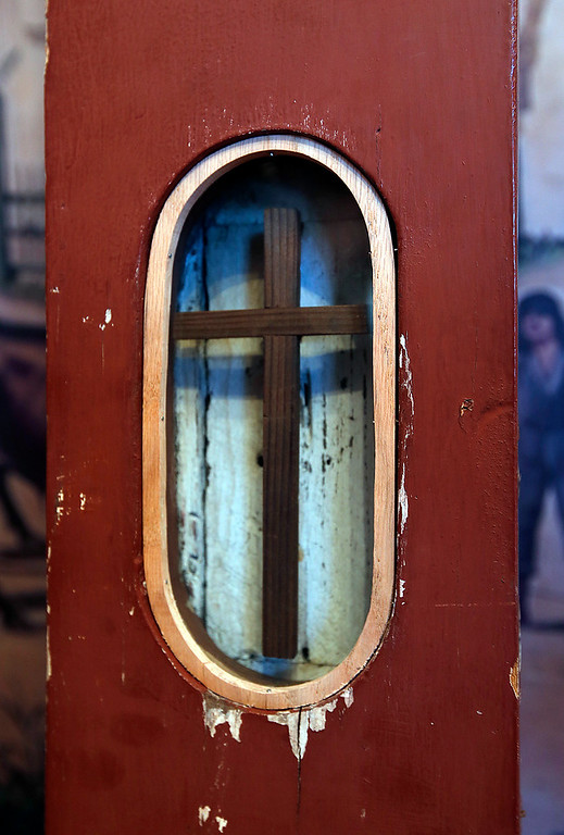 . Inside the 1902-circa Mission Santa Clara cross on display at the Roberto Adobe and Sunol House Museum in San Jose, Calif., Monday, Aug. 22, 2016, is a small cross made from the wood from the mission\'s original 1777 cross.  (Karl Mondon/Bay Area News Group)