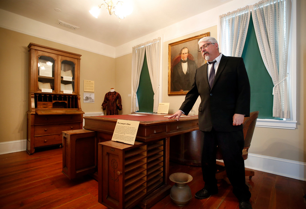 . One exhibit in the Roberto Adobe and Sunol House Museum Paul Bernal is particularly proud of displaying is the actual desk of Peter Burnett, the first governor of California. Bernal showed if off Monday, Aug. 22, 2016, during a preview for the museum\'s opening in San Jose, Calif. In the corner is the scarlet-and-black dress that his wife, Harriet, wore to an inaugural ball on Dec. 27, 1849. (Karl Mondon/Bay Area News Group)