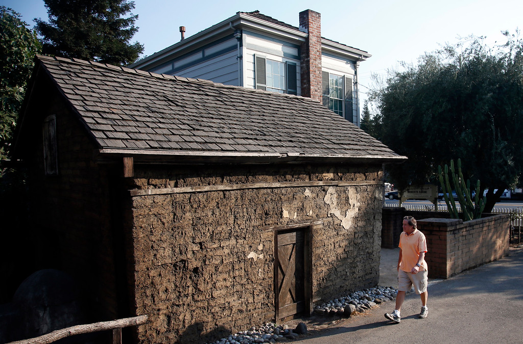 . Ken Machado, president of the California Pioneers of Santa Clara County, walks past the Roberto Adobe in San Jose, Calif., Tuesday, Aug. 23, 2016. The Willow Glen structure was built in 1836 and will reopen to the public as part of the Roberto Adobe and Sunol House Museum. (Karl Mondon/Bay Area News Group)