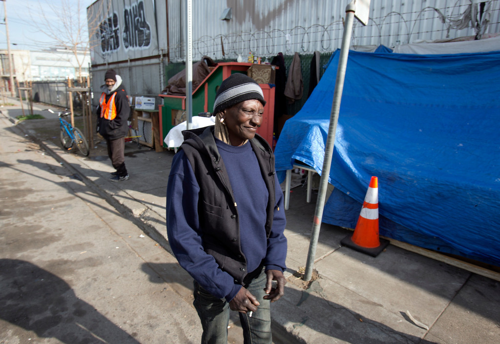 ". ""Wonder,\"" a homeless woman who now lives in the shelter built for her by Greg Kloehn, stands near her place on the streets of west Oakland, Calif., Tuesday, Dec. 31, 2013. (D. Ross Cameron/Bay Area News Group)"