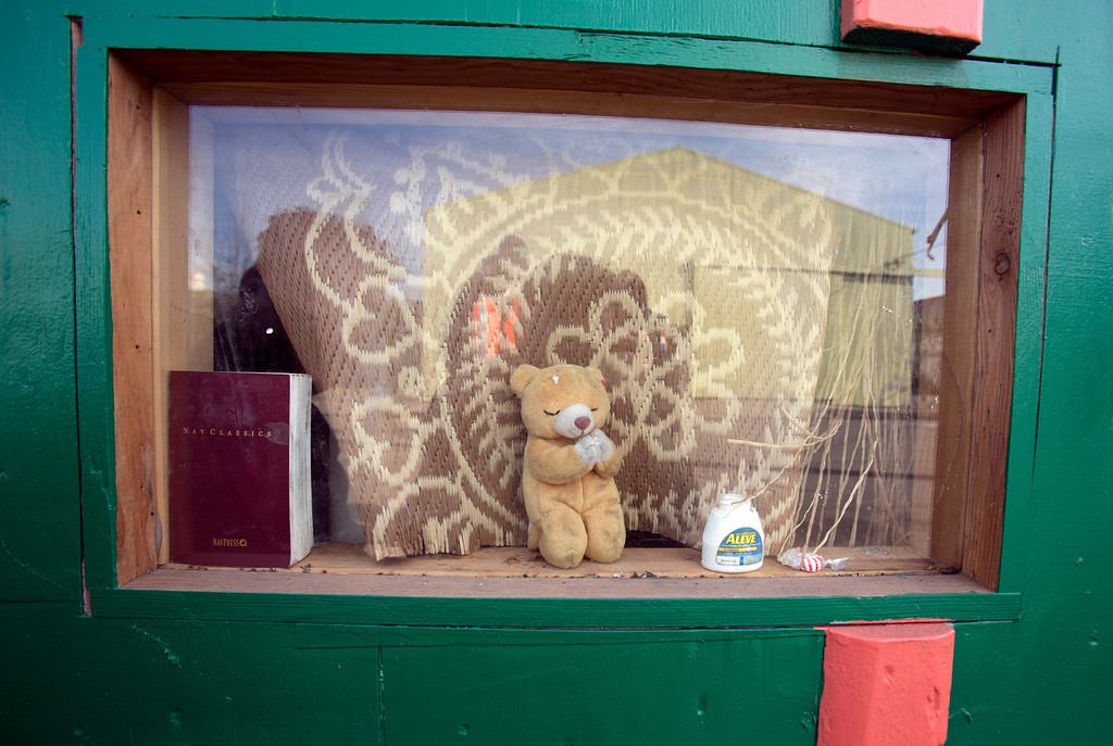 ". A ""prayer bear\"" sits in the window of a rolling shelter occupied by \""Wonder,\"" a homeless woman who once lived under just a discarded couch with a tarp thrown over it, photographed Tuesday, Dec. 31, 2013. (D. Ross Cameron/Bay Area News Group)"