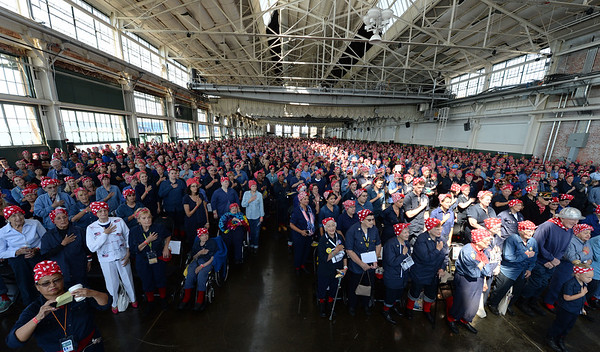 Thousands of people dressed as Rosie the Riveter sing the National Anthem during a Rosie the Riveter event held at the Craneway Pavilion in Richmond, Calif., on Saturday, Aug. 13, 2016. The Rosie the Riveter/WWII Home Front National Historical Park, along with the Rosie the Riveter Trust and the City of Richmond, made an attempt to break the Guinness World Book of Records record for most people dressed as Rosie the Riveter. The Home Front Festival, in Marina Bay Park, followed with music, food and fun for Rosie's of all ages. (Dan Honda/Bay Area News Group)
