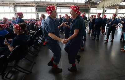 Diane Harris, left, and Margo Dean, right, both of El Sobrante, dance during a Rosie the Riveter event held at the Craneway Pavilion in Richmond, Calif., on Saturday, Aug. 13, 2016. The Rosie the Riveter/WWII Home Front National Historical Park, along with the Rosie the Riveter Trust and the City of Richmond, made an attempt to break the Guinness World Book of Records record for most people dressed as Rosie the Riveter. The Home Front Festival, in Marina Bay Park, followed with music, food and fun for Rosie's of all ages. (Dan Honda/Bay Area News Group)