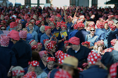 Thousands of people dressed as Rosie the Riveter participate in a Rosie the Riveter event held at the Craneway Pavilion in Richmond, Calif., on Saturday, Aug. 13, 2016. The Rosie the Riveter/WWII Home Front National Historical Park, along with the Rosie the Riveter Trust and the City of Richmond, made an attempt to break the Guinness World Book of Records record for most people dressed as Rosie the Riveter. The Home Front Festival, in Marina Bay Park, followed with music, food and fun for Rosie's of all ages. (Dan Honda/Bay Area News Group)