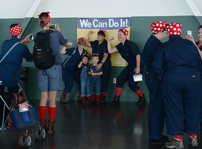 People take pictures during a Rosie the Riveter event held at the Craneway Pavilion in Richmond, Calif., on Saturday, Aug. 13, 2016. The Rosie the Riveter/WWII Home Front National Historical Park, along with the Rosie the Riveter Trust and the City of Richmond, made an attempt to break the Guinness World Book of Records record for most people dressed as Rosie the Riveter. The Home Front Festival, in Marina Bay Park, followed with music, food and fun for Rosie's of all ages. (Dan Honda/Bay Area News Group)