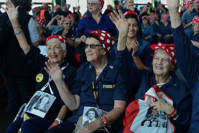 Kay Morrison, of Fairfield, left, Marian Wynn, center, of Fairfield, and Priscilla Elder, right, of Pinole, proudly raise their hands to acknowledge the fact that they were real Rosie the Riveters during World War II at a Rosie the Riveter event held at the Craneway Pavilion in Richmond, Calif., on Saturday, Aug. 13, 2016. The Rosie the Riveter/WWII Home Front National Historical Park, along with the Rosie the Riveter Trust and the City of Richmond, made an attempt to break the Guinness World Book of Records record for most people dressed as Rosie the Riveter. The Home Front Festival, in Marina Bay Park, followed with music, food and fun for Rosie's of all ages. (Dan Honda/Bay Area News Group)