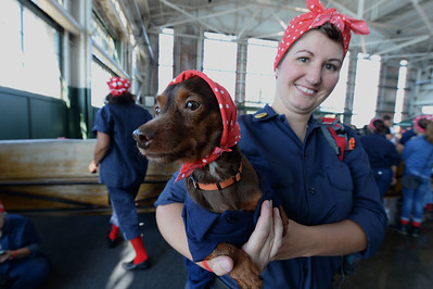 Stephanie Haney and her dog Lenny came all the way from Ohio to participate in a Rosie the Riveter event held at the Craneway Pavilion in Richmond, Calif., on Saturday, Aug. 13, 2016. The Rosie the Riveter/WWII Home Front National Historical Park, along with the Rosie the Riveter Trust and the City of Richmond, made an attempt to break the Guinness World Book of Records record for most people dressed as Rosie the Riveter. The Home Front Festival, in Marina Bay Park, followed with music, food and fun for Rosie's of all ages. (Dan Honda/Bay Area News Group)