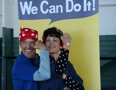 Jan Kovacic, left, and Julie Cummings, right, both of Lafayette, have their photo taken during a Rosie the Riveter event held at the Craneway Pavilion in Richmond, Calif., on Saturday, Aug. 13, 2016. The Rosie the Riveter/WWII Home Front National Historical Park, along with the Rosie the Riveter Trust and the City of Richmond, made an attempt to break the Guinness World Book of Records record for most people dressed as Rosie the Riveter. The Home Front Festival, in Marina Bay Park, followed with music, food and fun for Rosie's of all ages. (Dan Honda/Bay Area News Group)