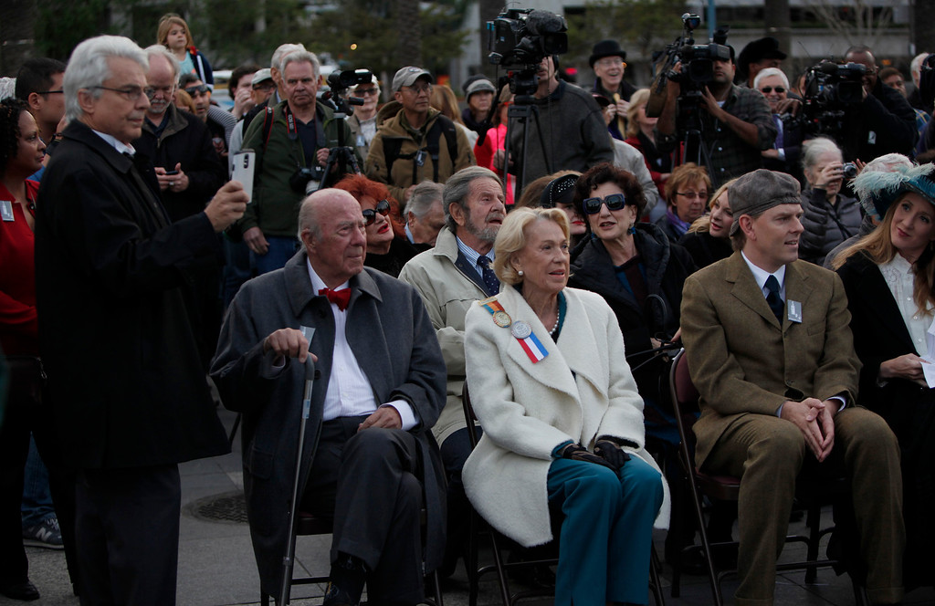 . Former Secretary of State George Shultz and his wife Charlotte Mailliard Shultz await the ceremonial relighting of the Ferry Building Tuesday evening, March 3, 2015, in San Francisco, Calif., as part of the 100th anniversary of the 1915 Panama-Pacific International Exposition.  (Karl Mondon/Bay Area News Group)