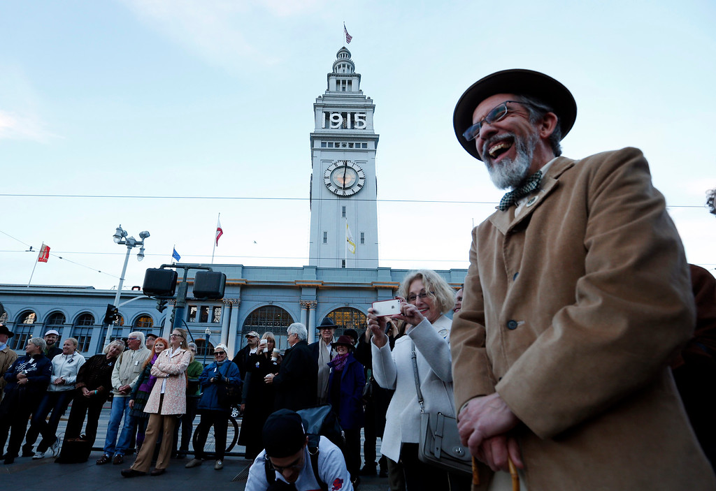 . Tom Bertino laughs before the ceremonial relighting of the San Francisco Ferry Building Tuesday evening, March 3, 2015, as part of the 100th anniversary of the 1915 Panama-Pacific International Exposition. (Karl Mondon/Bay Area News Group)