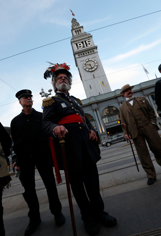. An Emperor Norton reenactor stands among other men in period costume waiting for the ceremonial relighting of the San Francisco Ferry Building Tuesday evening, March 3, 2015, as part of the 100th anniversary of the 1915 Panama-Pacific International Exposition. The lights will remain lit until Dec. 4, the night the original fair closed. (Karl Mondon/Bay Area News Group)