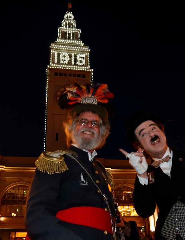 . Emperor Norton and Charlie Chaplin actors hold court after a ceremonial relighting of the San Francisco Ferry Building Tuesday evening, March 3, 2015, as part of the 100th anniversary of the 1915 Panama-Pacific International Exposition. (Karl Mondon/Bay Area News Group)