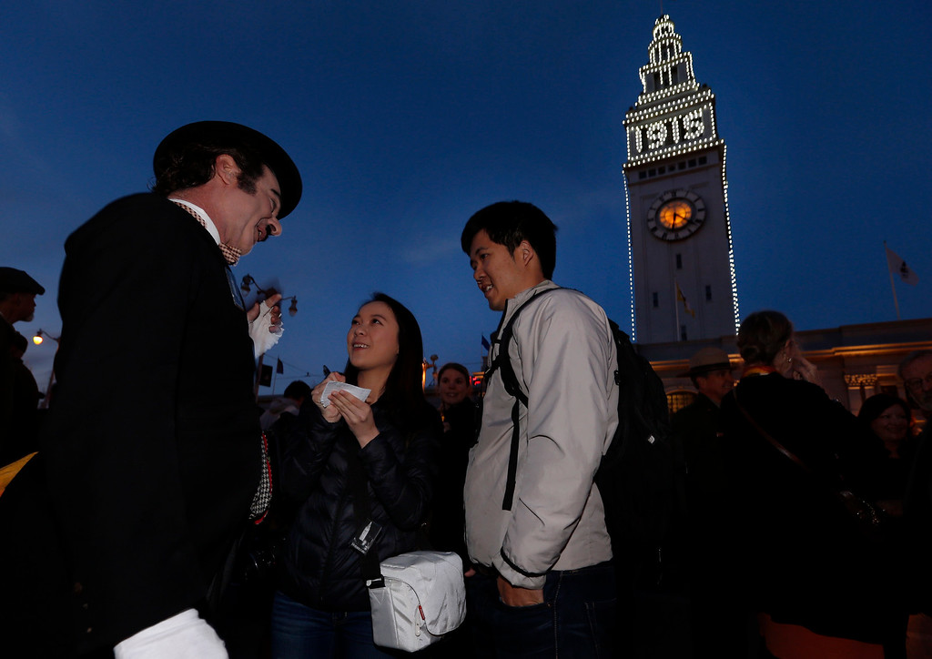 . A Charlie Chaplin actor holds court during a ceremonial relighting of the San Francisco Ferry Building Tuesday evening, March 3, 2015, as part of the 100th anniversary of the 1915 Panama-Pacific International Exposition. (Karl Mondon/Bay Area News Group)