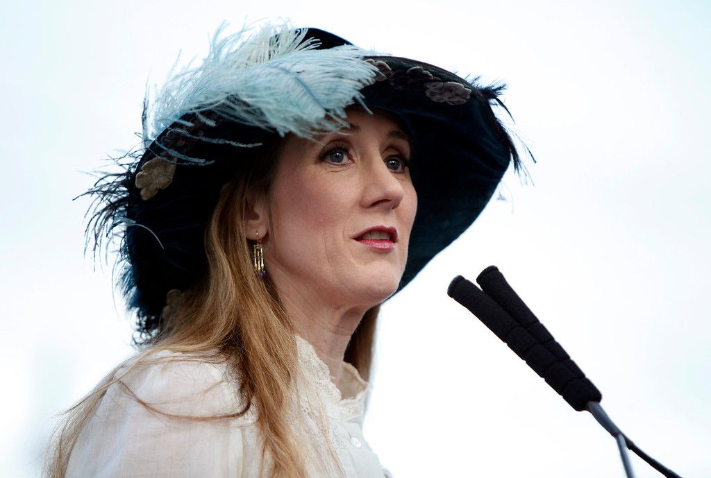 """. Laura Ackley, author of \""""San Francisco\'s Jewel City,\"""" wears period clothing to the ceremonial relighting of the Ferry Building Tuesday evening, March 3, 2015, as part of the 100th anniversary of the 1915 Panama-Pacific International Exposition. Ackley\'s book chronicles the exposition that symbolized the city\'s rebirth after the 1906 Earthquake. (Karl Mondon/Bay Area News Group)"""