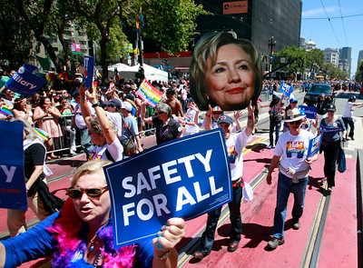 SF for Hillary carries a portrait of the Democratic presidential candidate up Market Street during the SF Pride parade in San Francisco, Calif., on Sunday, June 26, 2016. (Karl Mondon/Bay Area News Group)
