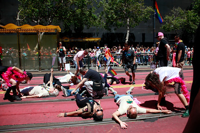 Marchers in the SF Pride parade enact a die-in along Market Street remembering those struck down by violence on Sunday, June 26, 2016, in San Francisco, Calif. (Karl Mondon/Bay Area News Group)