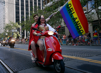 Dykes on Bikes carried Orlando flags as they led the SF Pride parade on Sunday, June 26, 2016, in San Francisco, Calif. (Karl Mondon/Bay Area News Group)