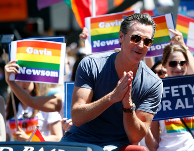 Lt. Gov. Gavin Newsom acknowledges the crowd while riding in the SF Pride parade on Sunday, June 26, 2016, in San Francisco, Calif. (Karl Mondon/Bay Area News Group)