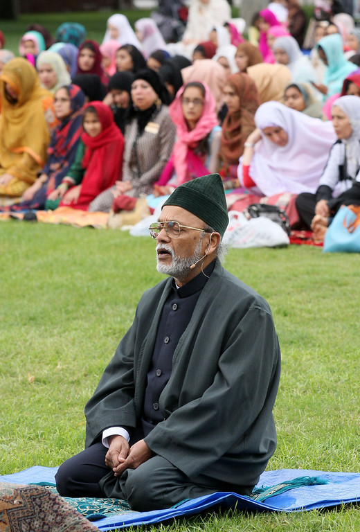 . Thousands gathered to pray and celebrate the end of Ramadan at the Alameda County Fairgrounds on Thursday, Aug. 8, 2013, in Pleasanton, Calif. The event sponsored by the San Ramon Valley Islamic Center featured guest Imam, Dr. Nazeer Ahmed, center front, an esteemed scientist and Islamic scholar.  (Jim Stevens/Bay Area News Group)