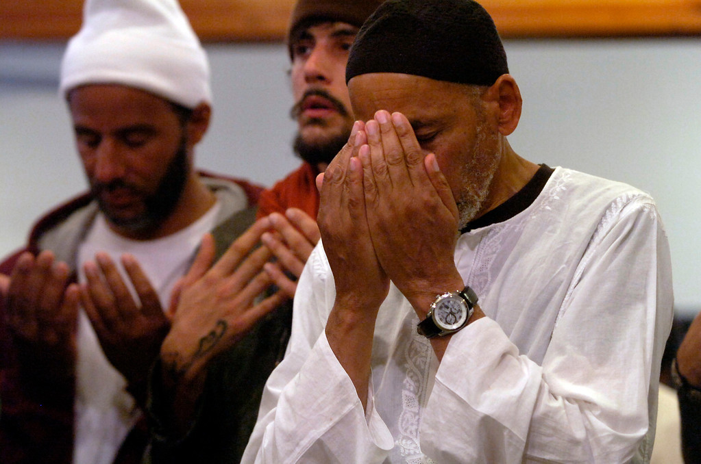 . Men pray during an Eid al-Fitr celebration at the Naqshbandi Sufi Order Masjid Al Iman mosque in Oakland, Calif., on Thursday, Aug. 8, 2013. Muslims worldwide recognize the conclusion of Ramadan with Eid al-Fitr celebrations. (Kristopher Skinner/Bay Area News Group)