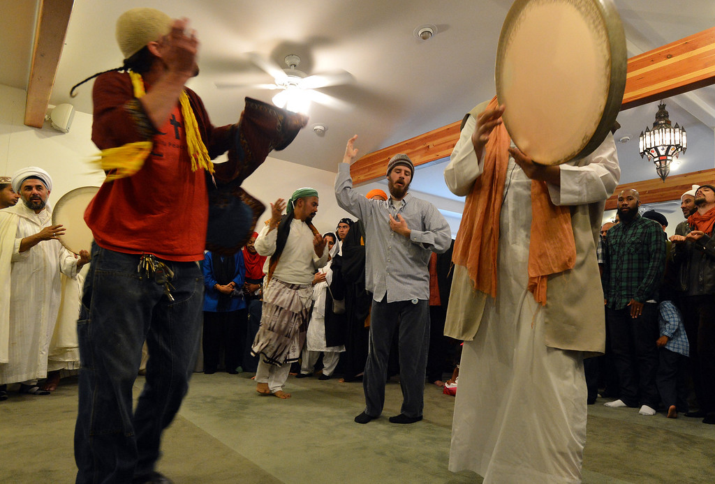 . Men dance and play drums during an Eid al-Fitr celebration at the Naqshbandi Sufi Order Masjid Al Iman mosque in Oakland, Calif., on Thursday, Aug. 8, 2013. (Kristopher Skinner/Bay Area News Group)