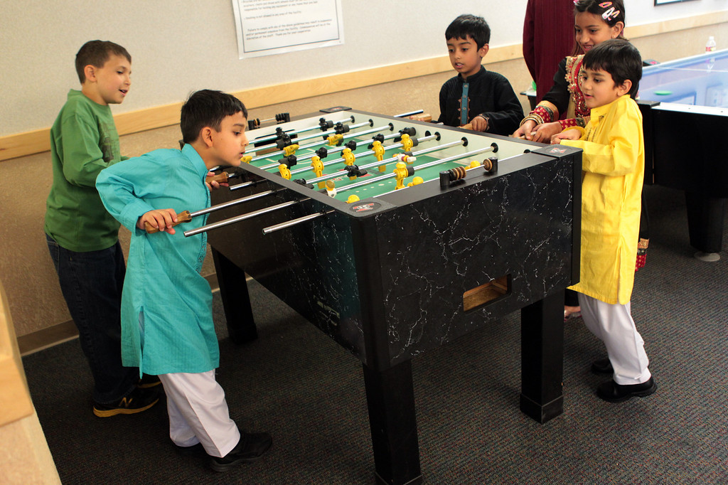 . Children play a game of foosball during an Eid al-Fitr celebration at the Silliman Center in Newark, Calif., on Thursday, Aug. 8, 2013.  Muslims around the world are marking the end of the holy fasting month of Ramadan with the celebration. (Anda Chu/Bay Area News Group)