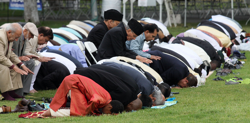 . Thousands gather to pray and celebrate the end of Ramadan at the Alameda County Fairgrounds on Thursday, Aug. 8, 2013, in Pleasanton, Calif. The event was sponsored by the San Ramon Valley Islamic Center.  (Jim Stevens/Bay Area News Group)