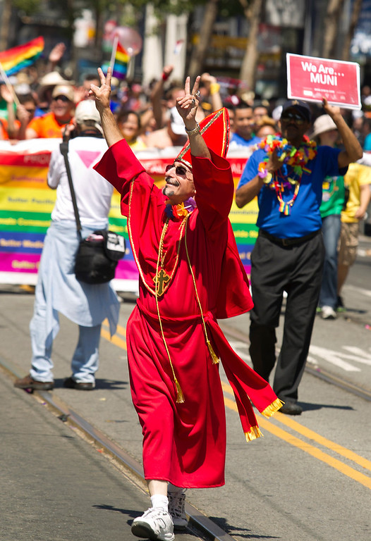 . A San Franciscan who identified himself as Tony waves to the crowd at the 43rd annual San Francisco Pride Parade, Sunday, June 30, 2013, in San Francisco, Calif. (D. Ross Cameron/Bay Area News Group)