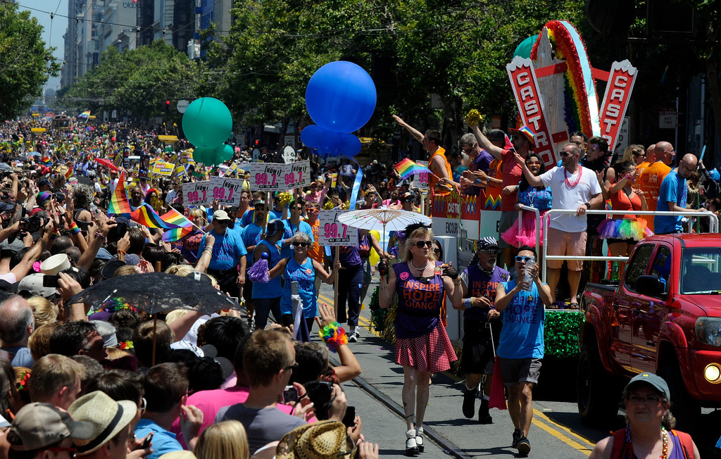 . Folks cheer at the 42nd San Francisco Pride Celebration and Parade as it travels down Market Street in San Francisco, Calif., on Sunday, June 30, 2013. (Susan Tripp Pollard/Bay Area News Group)