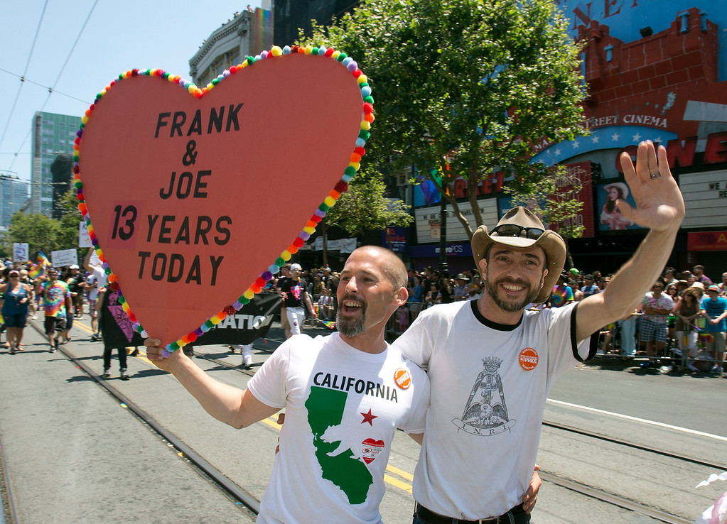 . Frank Capley-Alfano, left, and partner Joe celebrate their 13th anniversary at the 43rd annual San Francisco Pride Parade, Sunday, June 30, 2013, in San Francisco, Calif. (D. Ross Cameron/Bay Area News Group)