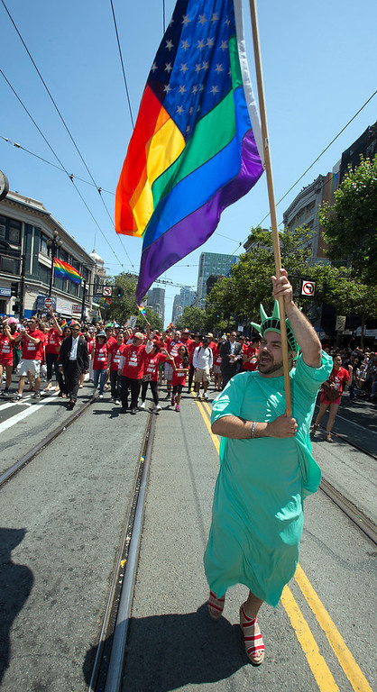 . An unidentified celebrant costumed as the Statue of Liberty marches along Market Street at the 43rd annual Pride Parade, Sunday, June 30, 2013, in San Francisco, Calif. (D. Ross Cameron/Bay Area News Group)