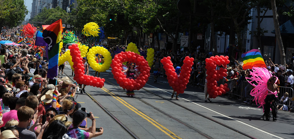 . Red and yellow balloons spell out LOVE WON as participants march along Market Street to a cheering crowd at the 42nd San Francisco Pride Celebration and Parade in San Francisco, Calif., on Sunday, June 30, 2013. (Susan Tripp Pollard/Bay Area News Group)