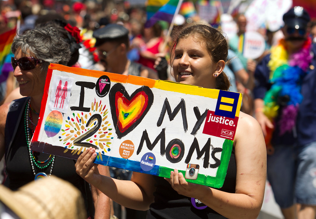 . An unidentified participant, apparently the daughter of a lesbian couple, attends the 43rd annual San Francisco Pride Parade, Sunday, June 30, 2013, in San Francisco, Calif. (D. Ross Cameron/Bay Area News Group)