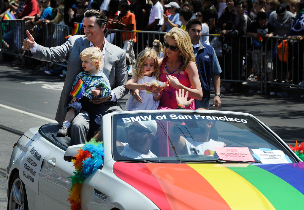 . California Lt. Gov. Gavin Newsom gives the thumbs-up sign to the crowd as he rides in the San Francisco Pride Parade as it travels along Market Street in San Francisco, Calif., on Sunday, June 30, 2013. (Susan Tripp Pollard/Bay Area News Group)