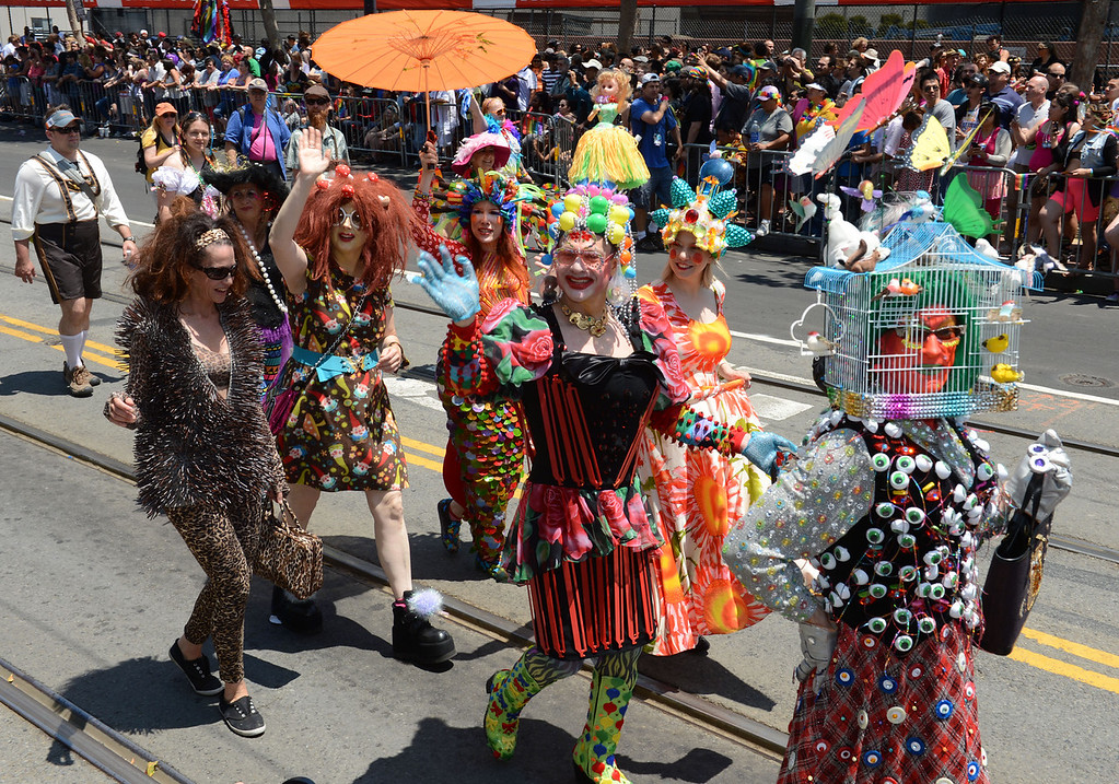 . Specators cheer as participants wave to the crowd during the 42nd San Francisco Pride Celebration and Parade as it travels along Market Street in San Francisco, Calif., on Sunday, June 30, 2013. (Susan Tripp Pollard/Bay Area News Group)