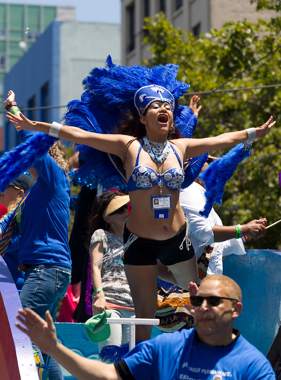 . Kaiser Permanente nurse Lupe Palacios, top, shows a less healthcare-oriented side of herself at the 43rd annual San Francisco Pride Parade, Sunday, June 30, 2013, in San Francisco, Calif. (D. Ross Cameron/Bay Area News Group)
