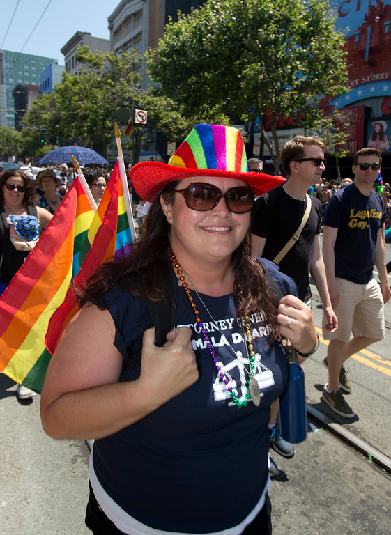 . Jennifer Hicklin, from Calif. Atty. General Kamala Harris\' office, walks along Market Street at the 43rd annual San Francisco Pride Parade, Sunday, June 30, 2013, in San Francisco, Calif. (D. Ross Cameron/Bay Area News Group)