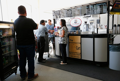 Barista, Robert Nielson, takes orders at the coffee cart at San Jose City Hall in San Jose, Calif., on Wednesday, April 6, 2016. The popular coffee cart has been owned by David Lindsay for almost a decade, but contract disputes with the city has pushed him to close the business. The cart serves coffee and snacks to more than 200 people a day. (Gary Reyes/Bay Area News Group)