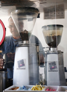 Barista, Robert Nielsen, prepares expresso coffee behind the grinders at the coffee cart at San Jose City Hall in San Jose, Calif., on Wednesday, April 6, 2016. Owner, David Lindsay, has run the popular coffee cart for almost a decade, but contract disputes with the city has pushed him to close the business. (Gary Reyes/Bay Area News Group)