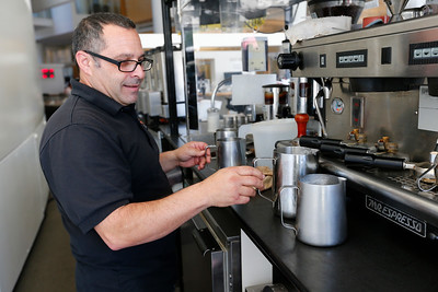 David Lindsay works the expresso machine at his coffee cart at San Jose City Hall in San Jose, Calif., on Wednesday, April 6, 2016. Lindsay has owned the popular coffee cart for almost a decade, but contract disputes with the city has pushed him to close the business. (Gary Reyes/Bay Area News Group)