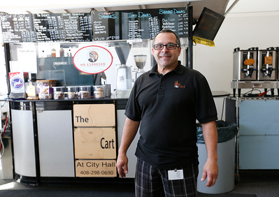 David Lindsay stands in front of his coffee cart at San Jose City Hall in San Jose, Calif., on Wednesday, April 6, 2016. Lindsay has owned the popular coffee cart for almost a decade, but contract disputes with the city has pushed him to close the business. (Gary Reyes/Bay Area News Group)