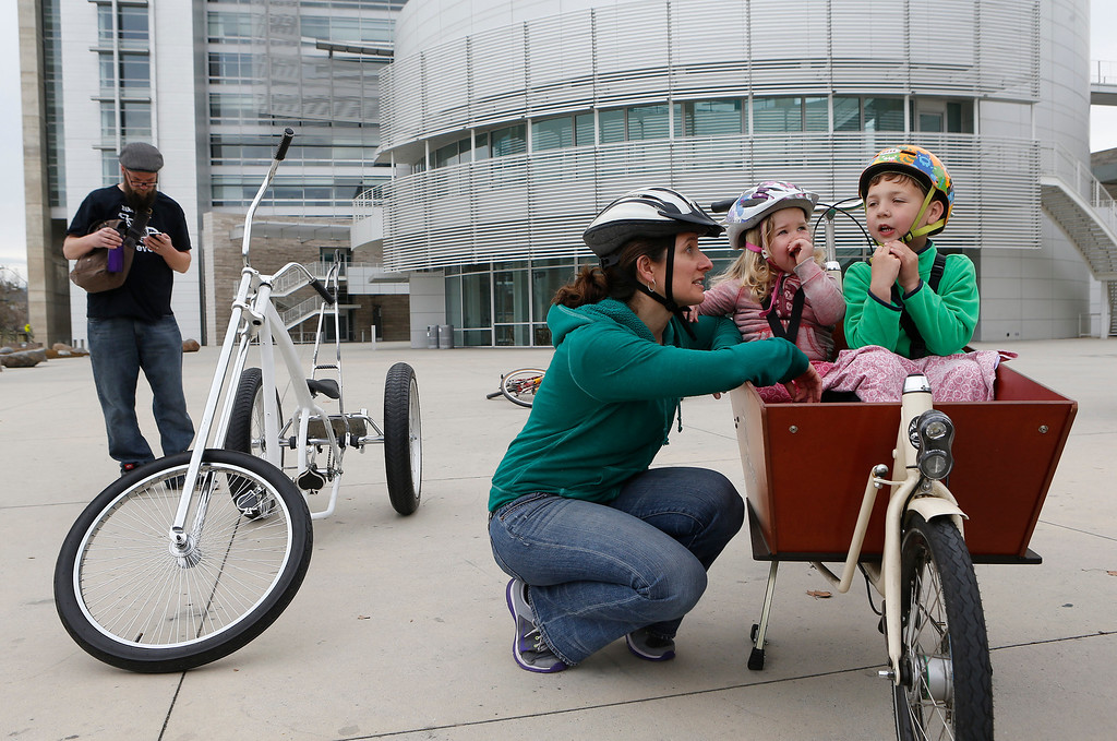 . Suzy Brooks, of San Jose, talks to her kids, Claudia Miller, 3, and Isaac Miller, 5, before a bike ride in San Jose, Calif., on Sunday, March 9, 2014. Dublin Lord Mayor Oisín Quinn joined cyclists on a seven-mile bicycle ride through the city as part of San Jose-Dublin Sister City Program festivities. Quinn is known for having championed the effort to create a bike sharing service in Dublin much akin to the similar service that\'s sprang up in San Jose and other Bay area cities. (Jim Gensheimer/Bay Area News Group)