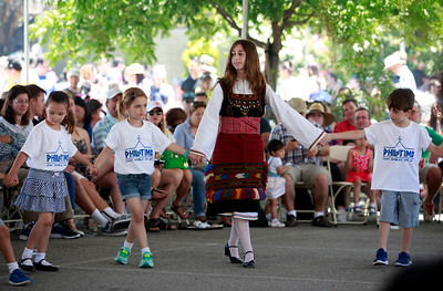 Maria Halatsis, 20, dances in ethic costume with a group of youngsters from the Philotimo dance group performing at the San Jose Greek Festival Sunday afternoon, June 5, 2016, at Saint Nicholas Greek Orthodox Church, in San Jose, Calif. (Karl Mondon/Bay Area News Group)