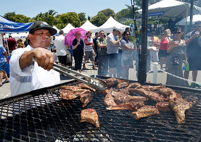 Ismael Lopez flips grilled lamb on the barbecue at the San Jose Greek Festival Sunday afternoon, June 5, 2016, at Saint Nicholas Greek Orthodox Church, in San Jose, Calif. (Karl Mondon/Bay Area News Group)