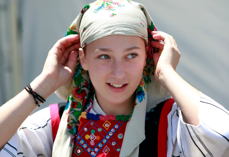Vasiliki Rousakis, 14, adjusts her costume before performing with the Polemistes dancers at the San Jose Greek Festival Sunday afternoon, June 5, 2016, at Saint Nicholas Greek Orthodox Church, in San Jose, Calif. (Karl Mondon/Bay Area News Group)