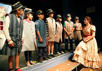 """Opera San Jose's Christine Capsuto, right,  works with Trace Elementary School students during a rehearsal for """"The Barber of Seville"""" on Wednesday afternoon, April 20, 2016,  in San Jose, Calif. Performers with Opera San Jose partnered with the Starting Arts program to bring music to the school. (Karl Mondon/Bay Area News Group)"""