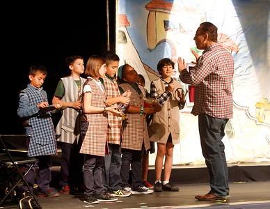 """Opera San Jose's Michael Taylor directs Trace Elementary School students during a rehearsal of """"The Barber of Seville"""" on Wednesday, April 20, 2016,  in San Jose, Calif. Performers with Opera San Jose partnered with the Starting Arts program to bring the music program to the school. (Karl Mondon/Bay Area News Group)"""