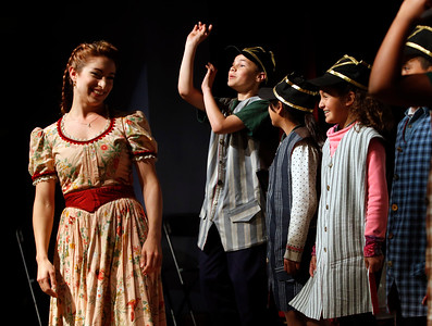 """Sean Maguire, center, gestures under the direction of Opera San Jose's Christine Capsuto, left, as fourth graders from Trace Elementary School rehearse for """"The Barber of Seville"""" on  Wednesday, April 20, 2016,  in San Jose, Calif. Performers with Opera San Jose partnered with the Starting Arts program to bring music to the school. (Karl Mondon/Bay Area News Group)"""