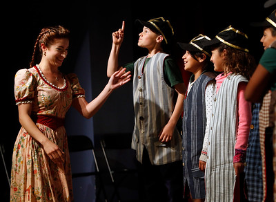 """Sean Maguire makes a point under the direction of Opera San Jose's Christine Capsuto, left, as fourth graders from Trace Elementary School rehearse for """"The Barber of Seville"""" on Wednesday, April 20, 2016,  in San Jose, Calif. Performers with Opera San Jose partnered with the Starting Arts program to bring music to the school. (Karl Mondon/Bay Area News Group)"""
